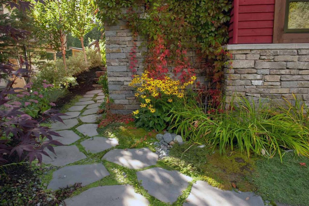 Natural stone walkway around side of house